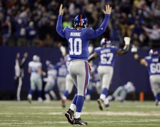 New York Giants Eli Manning reacts after Brandon Jacobs catches a 74 yard touchdown pass in the third quarter against the Dallas Cowboys at Giants Stadium