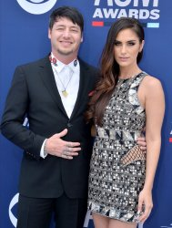 Jon Stone and Brittainy Taylor attend the Academy of Country Music Awards in Las Vegas