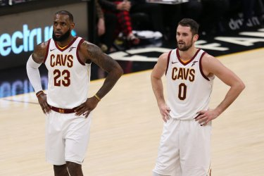Cleveland Cavaliers' LeBron James (23) stands alongside Kevin Love during their game against the Memphis Grizzlies