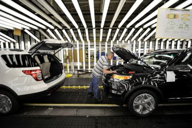 Worker inspects cars at Ford Plant in Chicago