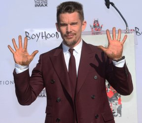 Ethan Hawke places hands and footprints in wet cement at TCL Chinese Theatre in Los Angeles