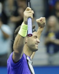 Grigor Dimitrov celebrates after defeating Roger Federer at the US Open
