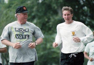 U.S. President Bill Clinton runs with John Fixx in Washington
