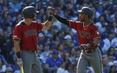 Diamondbacks Jarrod Dyson hits a solo home run against Cubs at Wrigley Field in Chicago