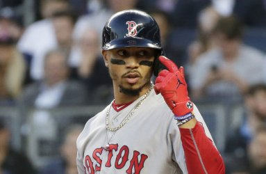 Red Sox Mookie Betts reacts after almost being hit by a pitch