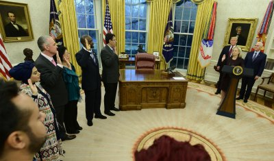 Trump Hosts a Naturalization Ceremony in Oval Office