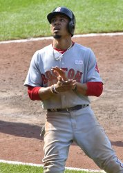 Red Sox' Mookie Betts reacts after scoring against Orioles in 9th inning