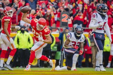 Chiefs Travis Kelce celebrates scoring a touchdown against the Houston Texans in the AFC Divisional Playoff