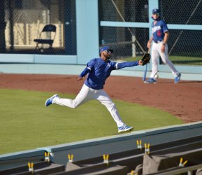 Los Angeles Dodgers Hold Summer Camp at Dodger Stadium