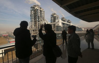 Engineers explain to journalists operations at the Lu'an Coal to Oil Project in Changzhi, China