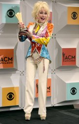 Dolly Parton wins an award backstage at the 51st  annual Academy of Country Music Awards in Las Vegas