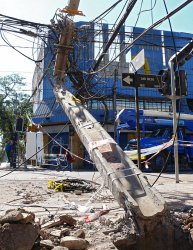 Crews begin to repair damaged infrastructure in Santiago, Chile