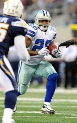 Cowboys Felix Jones rushes against the San Diego Chargers