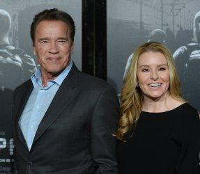 "Arnold Schwarzenegger and Heather Milligan attend ""The 15:17 to Paris"" premiere in Burbank, California"