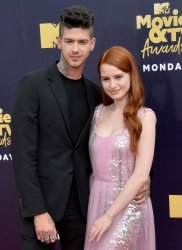 Travis Mills and Madelaine Petsch attend the 2018 MTV Movie & TV Awards in Santa Monica, California