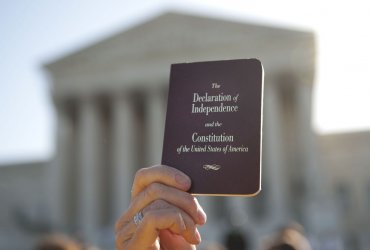 Pro and Anti-health care reform supporters rally in front of the Supreme Court in Washington