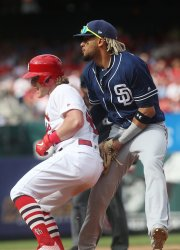 St. Louis Cardinals Harrison Bader is tagged out during a rundown