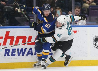 San Jose Sharks Justin Braun blocks St. Louis Blues David Perron