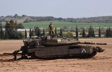 Israeli Soldiers Work On A Tank On Israel-Gaza Border