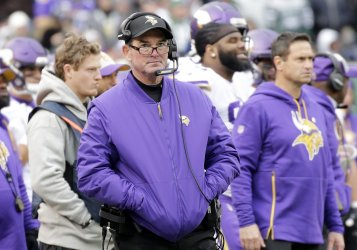 Vikings head coach Mike Zimmer stands on the sidelines