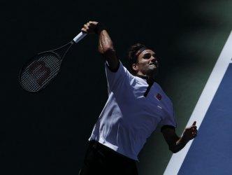 Roger Federer serves at the US Open