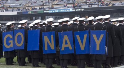 Navy midshipmen  fill the field during pregame ceremonies.