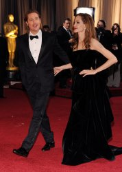Angelina Jolie and Brad Pitt arrive for the 84th Academy Awards in Los Angeles