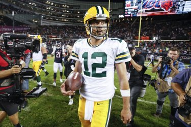 Packers quarterback Aaron Rodgers leaves the field in Chicago