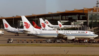 Air China airliners are parked at gates in Beijing, China