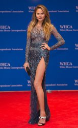 Attendees walk the red carpet at the White House Correspondent's Association Gala