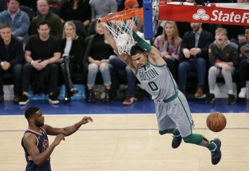 Boston Celtics Jayson Tatum dunks the basketball