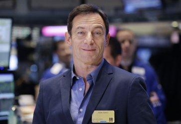 Jason Isaacs rings the Closing Bell at the NYSE