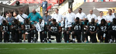 Jacksonville Jaguars Players Kneel during Playing of National Anthem in London