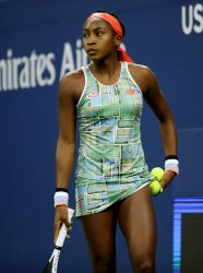 Coco Gauff serves at the US Open