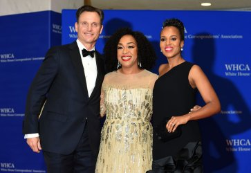Tony Goldwyn, Shondra Rhimes and Kerry Washington pose on the red carpet at the White House Correspondents' Association Dinner