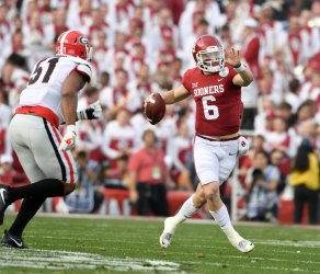 Oklahoma Sooners quarterback Baker Mayfield rolls out against the Georgia Bulldogs
