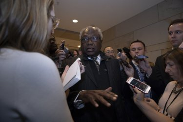 Rep. Jim Clyburn speaks to reporters as he arrives at a Democratic caucus meeting