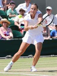Jarmila Groth plays a backhand at the Wimbledon Championships