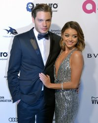 Sarah Hyland and Dominic Sherwood attend the Elton John Aids Foundation Oscar viewing party