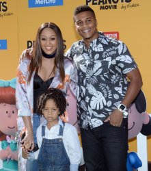 """Tia Mowry and husband and son attend """"The Peanuts Movie"""" premiere in Los Angeles"""