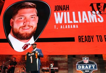 Jonah Williams from Alabama holds up a jersey after being picked eleventh