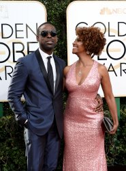 Sterling K. Brown and Ryan Michelle Bathe attend the 74th annual Golden Globe Awards in Beverly Hills