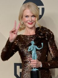 Nicole Kidman wins an award at the 24th annual SAG Awards in Los Angeles
