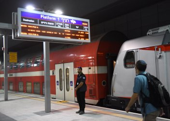 An Israeli Security Guard Stands On The Platform Of The New Jerusalem Fast Train