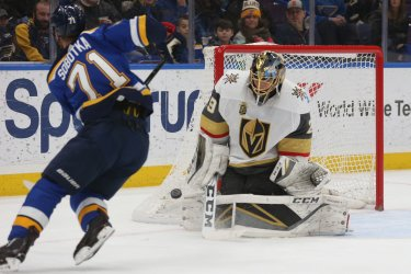 St. Louis Blues Vladimir Sobotka shoots puck at  Vegas Golden Knights goaltender Marc-Andre Fleury