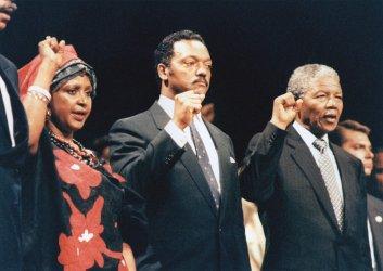 Winnie Mandela, Jesse Jackson, and Nelson Mandela at Rally