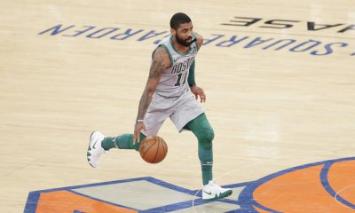 Celtics Kyrie Irving brings the basketball up the court