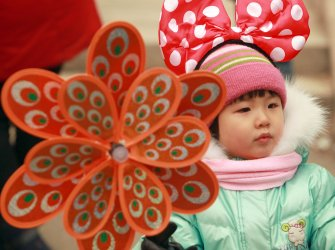 Chinese visit a temple fair during Spring Festival in Beijing