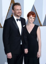 Jason Segel and Alexis Mixter arrive for the 88th Academy Awards in Hollywood