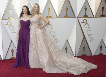 Ashley Judd and Mira Sorvino arrive at the 90th Annual Academy Awards in Hollywood